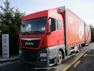MAN TGX 26.400 6x2 E6 curtainsider truck